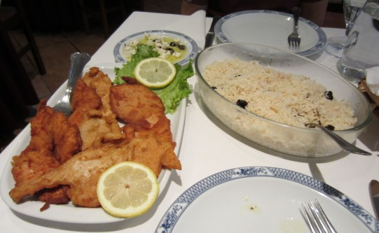 A typical meal from a pilgrims' menu: cheese and olives (top), rice and fried chicken. Served at Casa Cecilia Restaurant near Vilarinho, Portugal. Eight fifty euros including soup entree and cinnamon apple dessert.