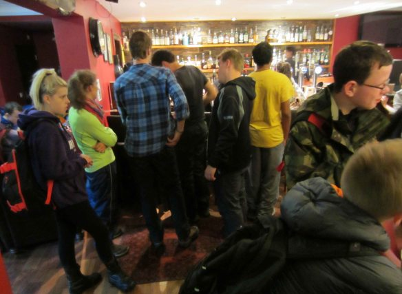 In the Bridge of Orchy Hotel walkers crowd the bar at 11.00 in the morning.