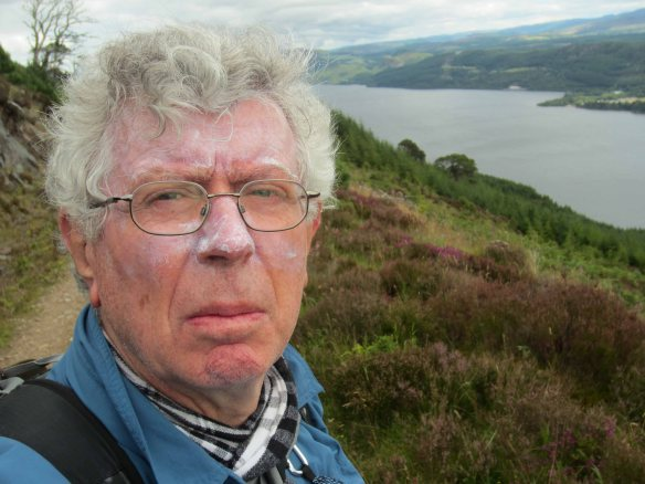 This is what happens to you when you do too much walking. Covered in sun screen I take a selfie on the heights above Loch Ness.