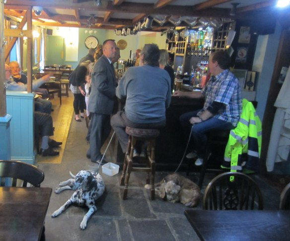 In the Bell Inn, Shepherdswell. Two dogs kept us company as we ate at the table on the left.