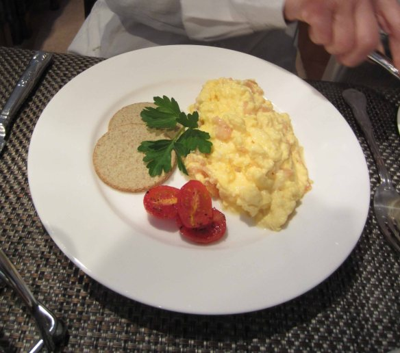 The more digestible option: scrambled eggs with (in this case) oatmeal cakes and cherry tomatoes.