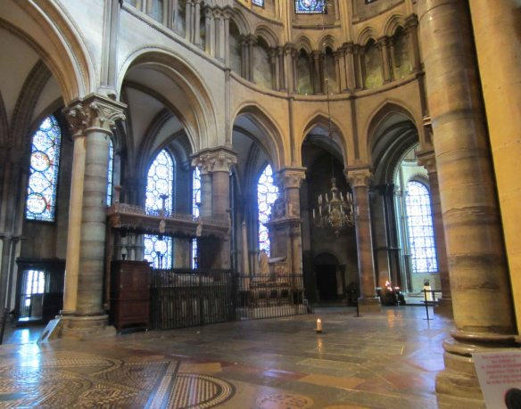 The absent tomb of Saint Thomas Becket, marked by a single candle in an empty space.