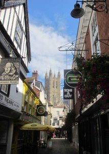 Canterbury Cathedral's main tower seen from a neighbouring narrow street.