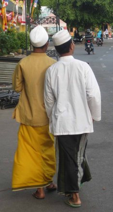 Two friends head home after mid afternoon prayers at Sumenep's Grand Mosque