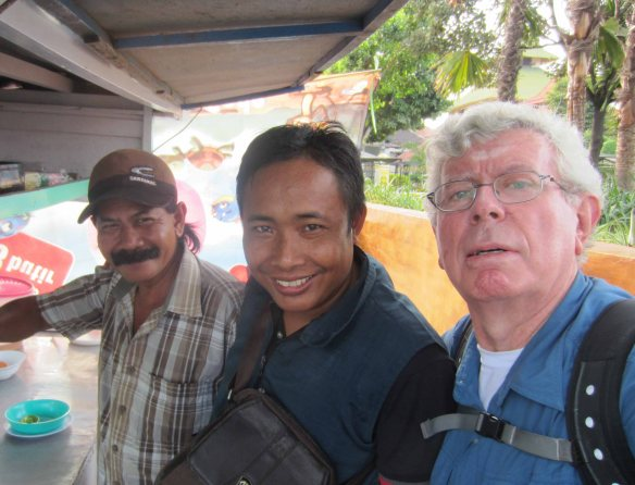 I take a selfie with Pak Sariman (left) and another customer Muhammad Hayat (centre).