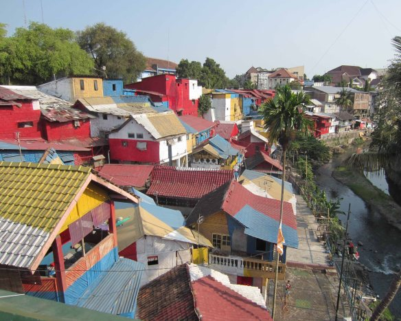The colourful favela on the banks of the Code River