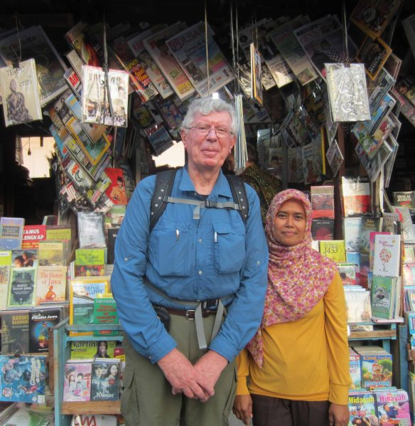 I pose with my favourite bookseller, Ibu Mini. She says her name fits her stature.
